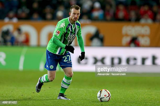 Maximilian Arnold of Wolfsburg runs with the ball during the Bundesliga match between FC Augsburg and VfL Wolfsburg at WWK Arena on November 29 2015...