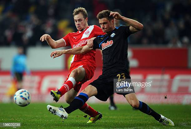 Maximilian Beister of Duesseldorf is challenged by Markus Palionis of Paderborn during the Second Bundesliga match between Fortuna Duesseldorf and SC...