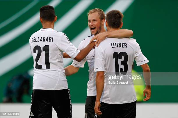 Maximilian Beister of Germany celebrates his team's first goal with his team mates Karim Bellarabi and Moritz Leitner during the Under 21Euro...