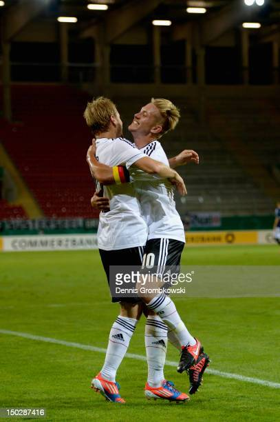 Maximilian Beister of Germany celebrates with teammate Lewis Holtby after scoring his team's third goal during the Under 21 international friendly...