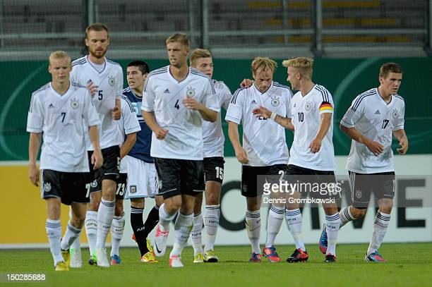 Maximilian Beister of Germany celebrates with teammates after scoring his team's first goal during the Under 21 international friendly match between...