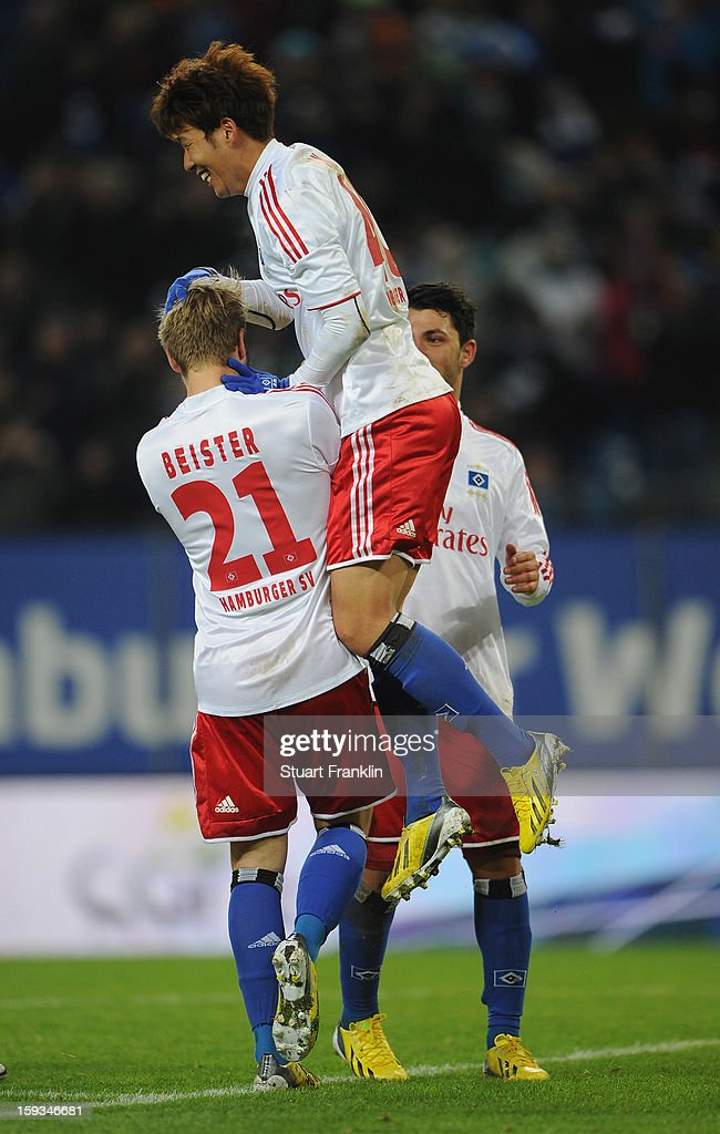 <a gi-track='captionPersonalityLinkClicked' href=/galleries/search?phrase=Maximilian+Beister&family=editorial&specificpeople=5704834 ng-click='$event.stopPropagation()'>Maximilian Beister</a> of Hamburg celebrates scoring his goal with Heung Min Son during the international friendly match between Hamburger SV and Austria Wien at Imtech Arena on January 12, 2013 in Hamburg, Germany.