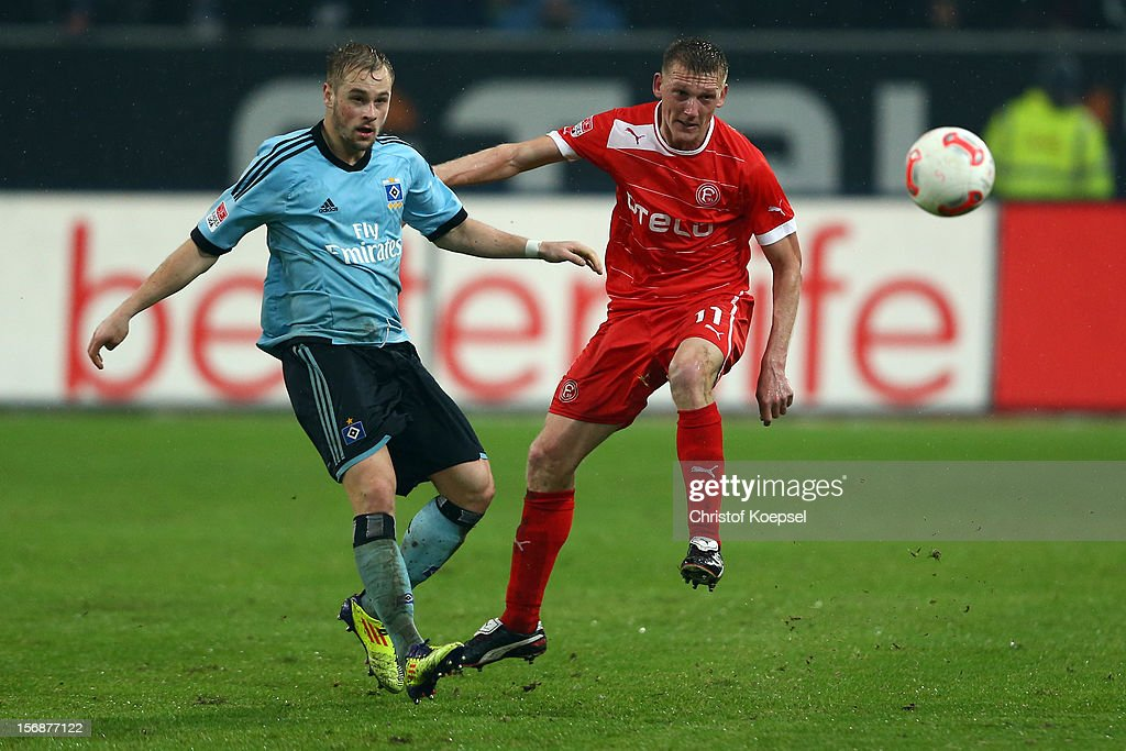 Maximilian Beister of Hamburg challenges Axel Bellinghausen of Duesseldorf during the Bundesliga match between Fortuna Duesseldorf and Hamburger SV at Esprit-Arena on November 23, 2012 in Duesseldorf, Germany.