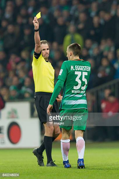 Maximilian Eggestein of Bremen gets from Referee Sascha Stegemann the yellow card during the Bundesliga match between Werder Bremen and Bayern...