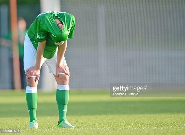 Maximilian Eggestein of Bremen stands dejected on the pitch during the B Juniors Bundesliga Semi Final match between between Werder Bremen and VfB...