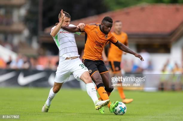 Maximilian Eggestein of Werder Bremen and Bright Enobakhare of Wolverhampton Wanderers during the preseason friendly between Werder Bremen and...