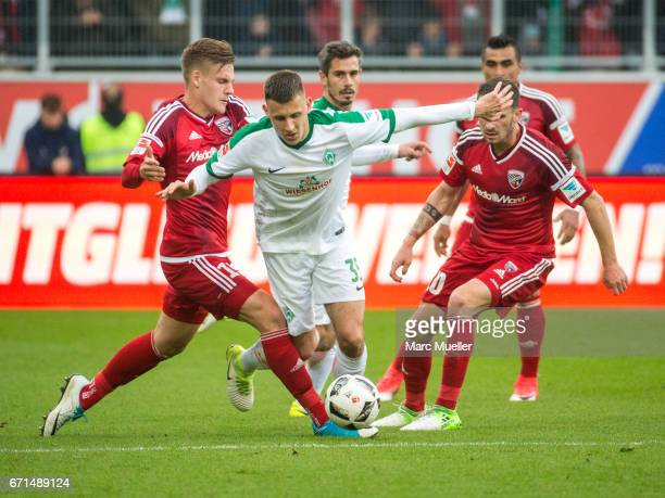 Maximilian Eggestein of Werder Bremen is challenged by Max Christiansen and Pascal Gro§ of Ingolstadt during the Bundesliga match between FC...