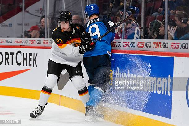 Maximilian Kammerer of Team Germany checks Julius Honka of Team Finland into the boards in a preliminary round game during the 2015 IIHF World Junior...