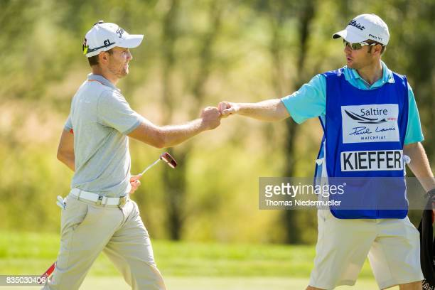 Maximilian Kiefer of Germany and his caddie are seen during day two of the Saltire Energy Paul Lawrie Matchplay at Golf Resort Bad Griesbach on...