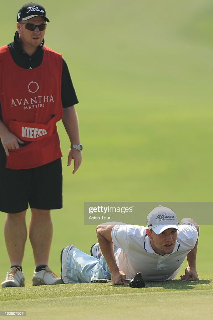 Maximilian Kiefer of Germany lines up a putt during day 4 of the Avantha Masters at Jaypee Greens Golf Course on March 17 2013 in Noida India