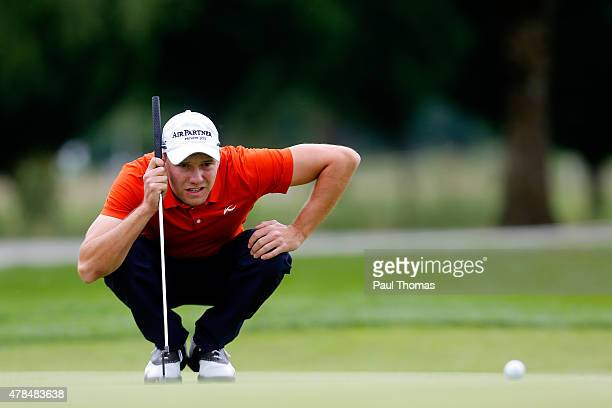 Maximilian Kieffer of Germany linesup a putt during the BMW International Open day one at the Eichenried Golf Club on June 25 2015 in Munich Germany