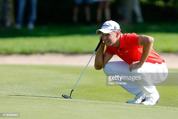 Maximilian Kieffer of Germany linesup a putt during the BMW International Open day two at the Eichenried Golf Club on June 26 2015 in Munich Germany