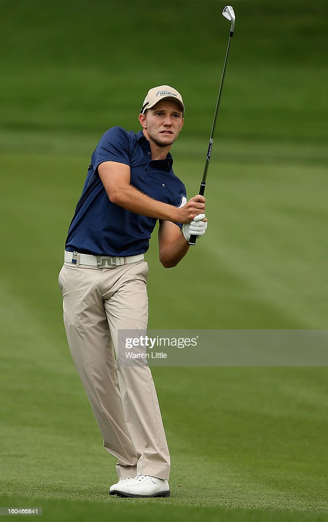 Maximilian Kieffer of Germany plays his second shot into the ninth green during the second round of the Omega Dubai Desert Classic at Emirates Golf Club on February 1, 2013 in Dubai, United Arab Emirates.