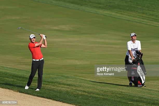 Maximilian Kieffer of Germany plays his third shot on the third hole during the first round of the Omega Dubai Desert Classic at The Emirates Golf...
