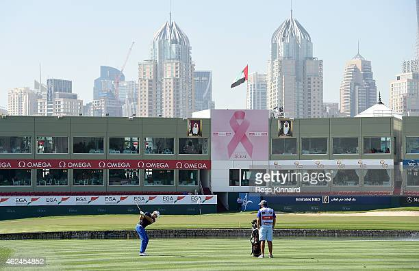 Maximilian Kieffer of Germany plays his third shot to the par five 18th hole during the first round of the Omega Dubai Desert Classic at the Emirates...