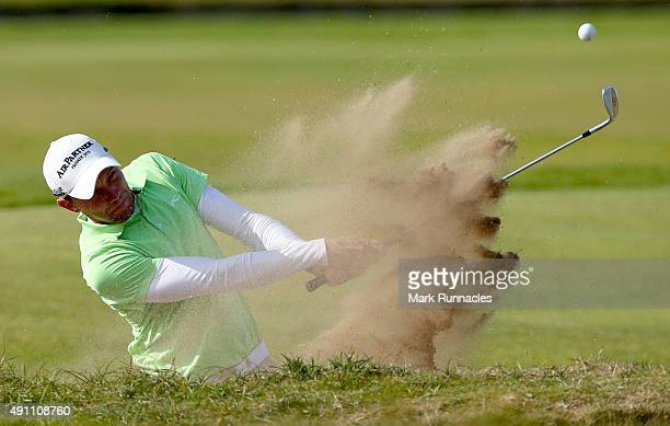 Maximilian Kieffer of Germany plays out from the bunker on the 18th hole during the third round of the 2015 Alfred Dunhill Links Championship at the...