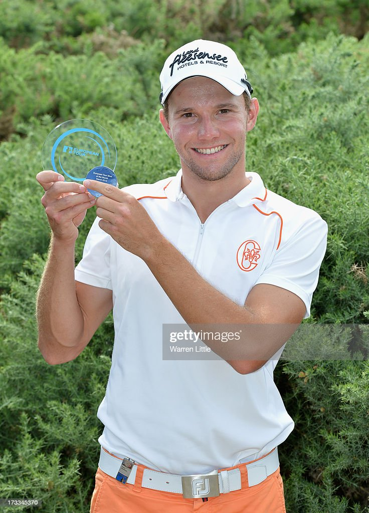 Maximilian Kieffer of Germany poses with the Shot of the Month award for April during the second round of the Aberdeen Asset Management Scottish Open at Castle Stuart Golf Links on July 12, 2013 in Inverness, Scotland.