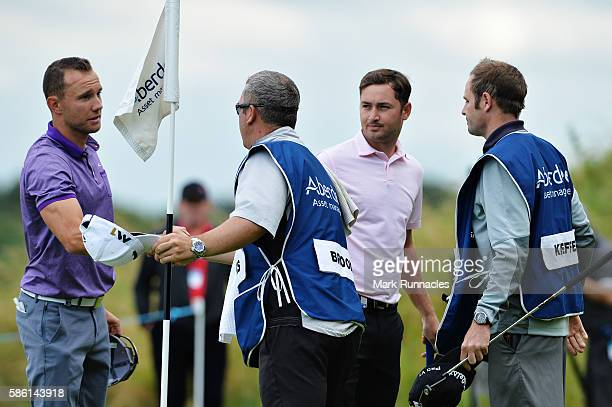 Maximilian Kieffer of Germany shakes hands with his caddy after beating Daniel Brooks of England on hole 17 on day two of the Aberdeen Asset...