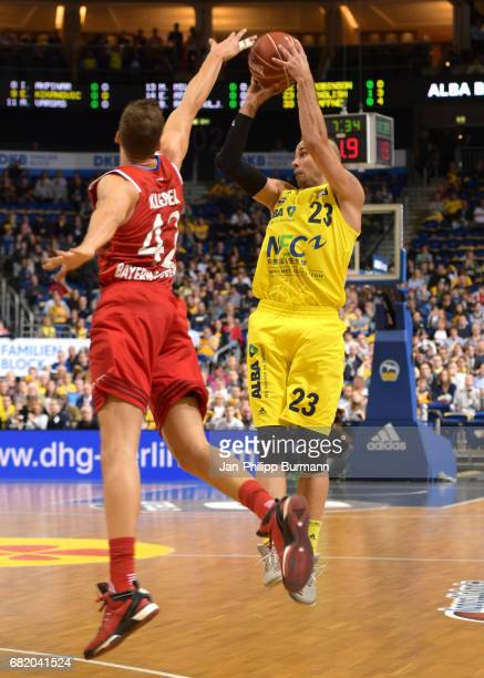 Maximilian Kleber of FC Bayern Muenchen and Carl English of Alba Berlin during the easyCredit BBL match between Alba Berlin and FC Bayern Muenchen on...