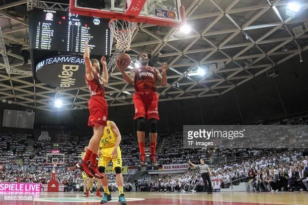 Maximilian Kleber of Munich and Devin Booker of Munich battle for the ball during the easyCredit BBL Basketball Bundesliga match between FC Bayern...