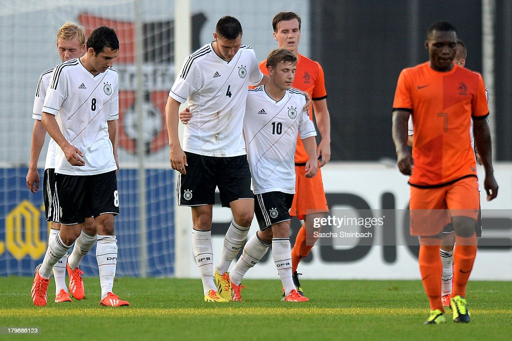 Maximilian Meyer (C) from Germany celebrates scoring his team's 4th goal with team mates during the U19 international friendly match between The Netherlands and Germany on September 6, 2013 in Nijmegen, Netherlands.