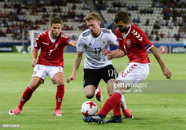 Maximilian Meyer of Germany and Andrew Hjulsager and Jakob Blbjerg of Denmark during their UEFA Under21 Championship Group C match between Germany...