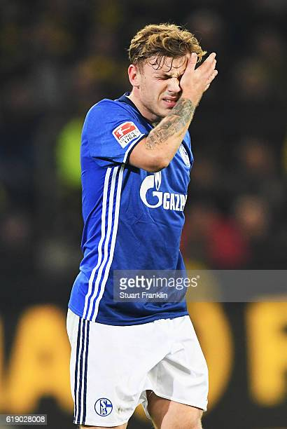 Maximilian Meyer of Schalke looks dejected during the Bundesliga match between Borussia Dortmund and FC Schalke 04 at Signal Iduna Park on October 29...