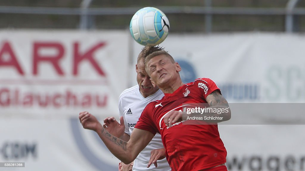 Maximilian Oesterhelweg of Elversberg challenges Marc-Philipp Zimmermann of Zwickau during Regionalliga Playoffs match between FSV Zwickau and SV Elversberg on May 25 on May 29, 2016 in Plauen, Germany.