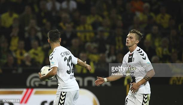 Maximilian Philipp and Vincenzo Grifo of SC Freiburg celebrate scoring a goal during the Bundesliga soccer match between Borussia Dortmund and SC...