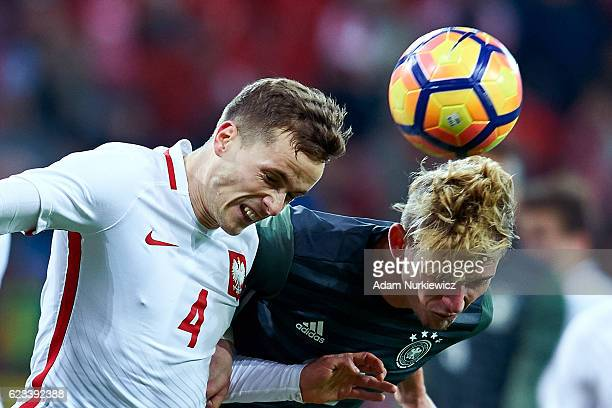 Maximilian Philipp from Germany fights for the ball with Tomasz Kedziora from Poland during the International Friendly soccer match between Poland...