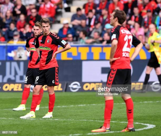 Maximilian Philipp Janik Haberer and Julian Schuster of SC Freiburg reacting after the Bundesliga match between Sport Club Freiburg and Werder Bremen...