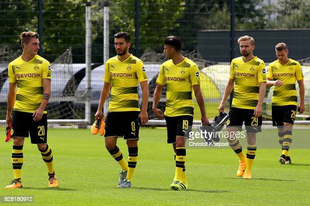 Maximilian Philipp Nuri Sahin Mahmoud Dahoud Marcel Schmelzer and Lukasz Piszczek of Borussia Dortmund on the way to the team presentation at Brackel...