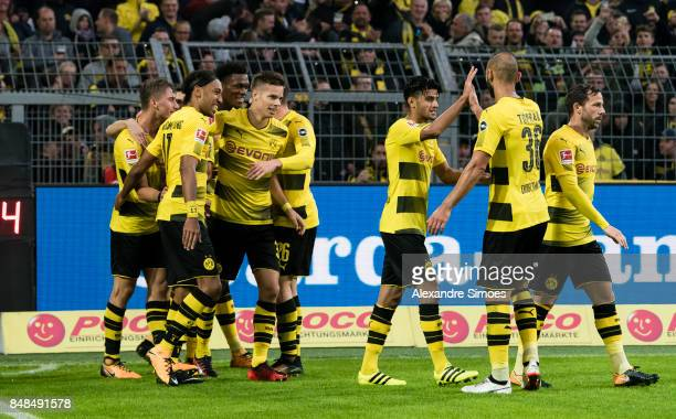 Maximilian Philipp of Borussia Dortmund celebrates after scoring a goal to make it 50 with his team mates during the Bundesliga match between...