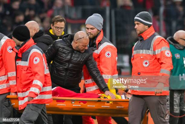 Maximilian Philipp of Borussia Dortmund gets injured during the Bundesliga match between Bayer 04 Leverkusen and Borussia Dortmund at BayArena on...