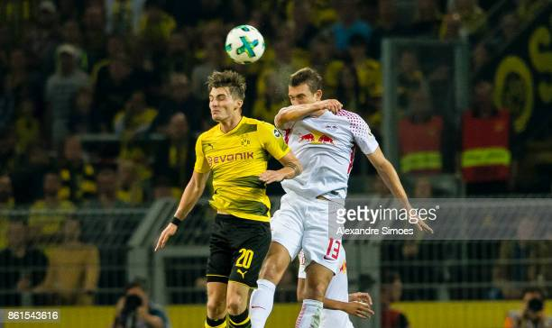 Maximilian Philipp of Borussia Dortmund in the battel for the ball against Stefan Ilsanker of RB Leipzig during the Bundesliga match between Borussia...