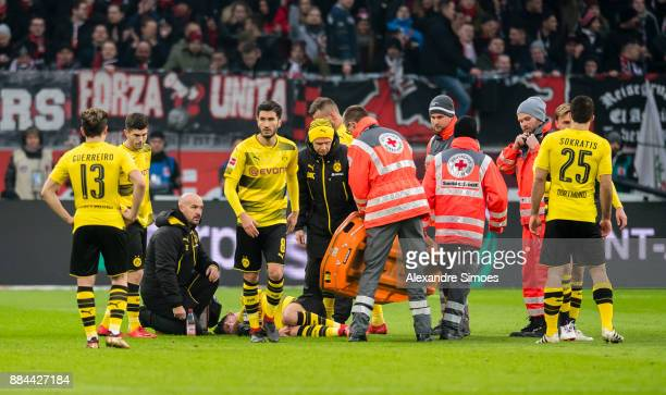 Maximilian Philipp of Borussia Dortmund is injured during the Bundesliga match between Bayer 04 Leverkusen and Borussia Dortmund at BayArena on...