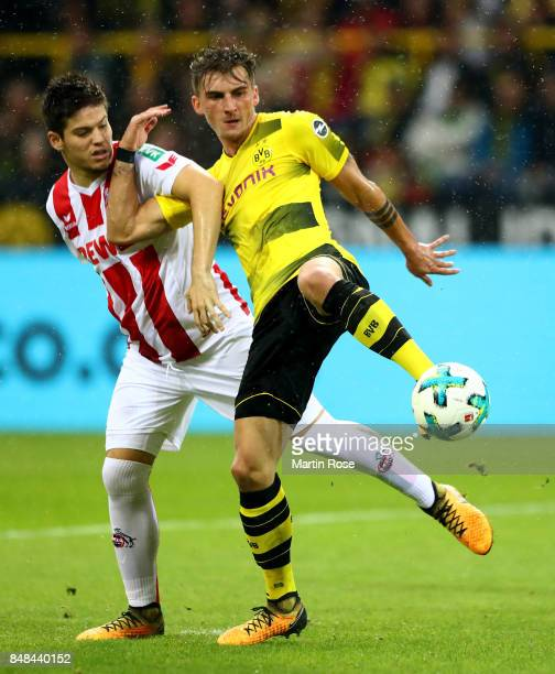 Maximilian Philipp of Dortmund and Jorge Mere Perez of Koeln battle for the ball during the Bundesliga match between Borussia Dortmund and 1 FC Koeln...