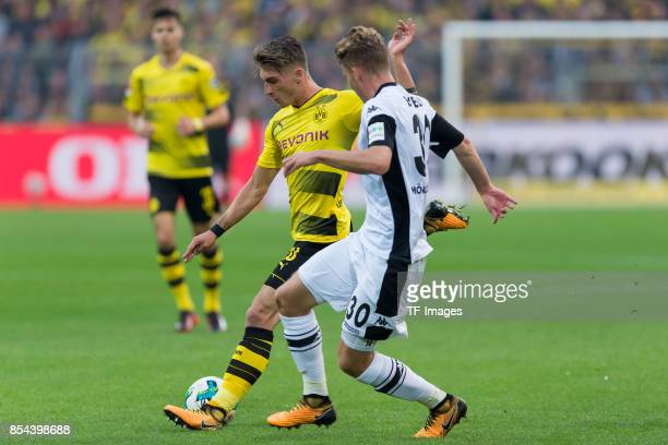 Maximilian Philipp of Dortmund and Nico Elvedi of Moenchengladbach battle for the ball during the Bundesliga match between Borussia Dortmund and...