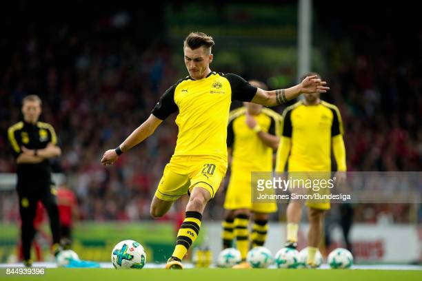 Maximilian Philipp of Dortmund and team mates warm up prior to the Bundesliga match between SportClub Freiburg and Borussia Dortmund at...