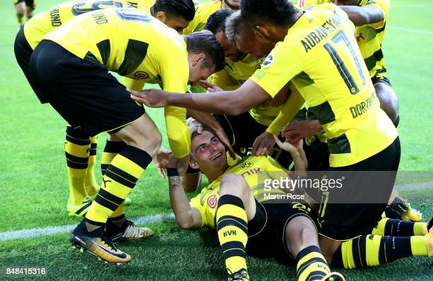 Maximilian Philipp of Dortmund celebrate with his team mates after he scores the opening goal during the Bundesliga match between Borussia Dortmund...