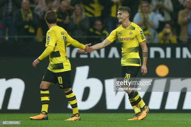 Maximilian Philipp of Dortmund celebrates with Mario Goetze of Dortmund after he scored his teams first goal to make it 10 during the Bundesliga...
