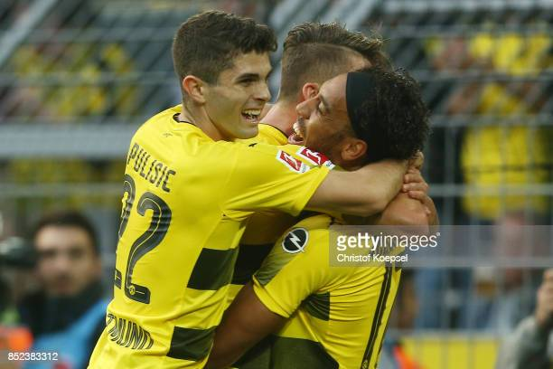 Maximilian Philipp of Dortmund celebrates with PierreEmerick Aubameyang of Dortmund and Lukasz Piszczek of Dortmund after he scored his teams first...