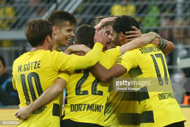 Maximilian Philipp of Dortmund celebrates with team mates after he scored his teams first goal to make it 10 during the Bundesliga match between...