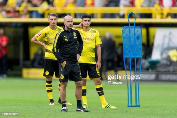 Maximilian Philipp of Dortmund Head coach Peter Bosz of Dortmund and Mahmound Dahoud of Dortmund looks on during the Borussia Dortmund Season Opening...