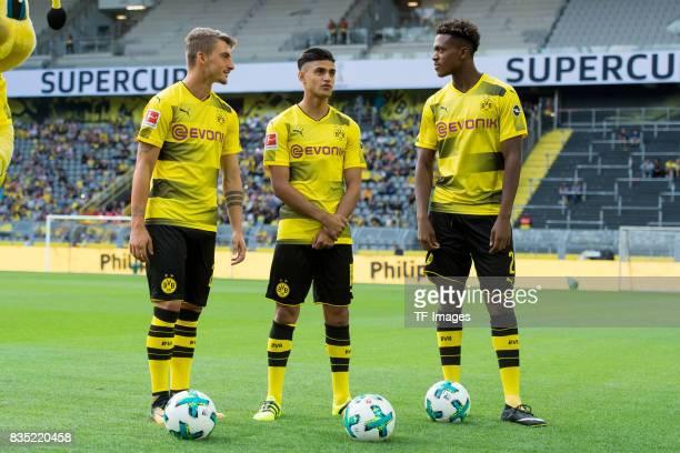 Maximilian Philipp of Dortmund Mahmound Dahoud of Dortmund and DanAxel Zagadou of Dortmund looks on during the Borussia Dortmund Season Opening...
