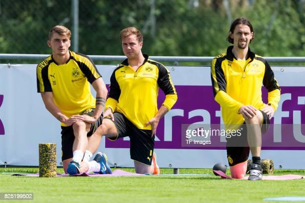 Maximilian Philipp of Dortmund Mario Goetze of Dortmund and Neven Subotic of Dortmund looks on during a training session as part of the training camp...
