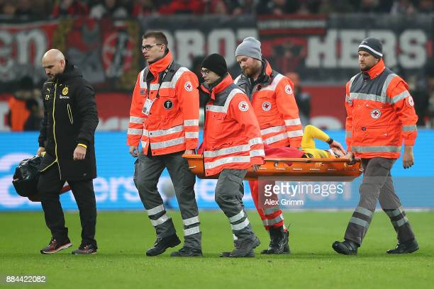 Maximilian Philipp of Dortmund on a stretcher injured during the Bundesliga match between Bayer 04 Leverkusen and Borussia Dortmund at BayArena on...