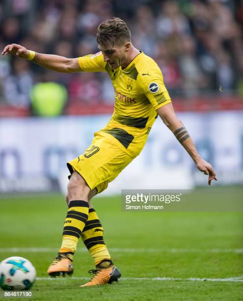 Maximilian Philipp of Dortmund scores his team's second goal during the Bundesliga match between Eintracht Frankfurt and Borussia Dortmund at...