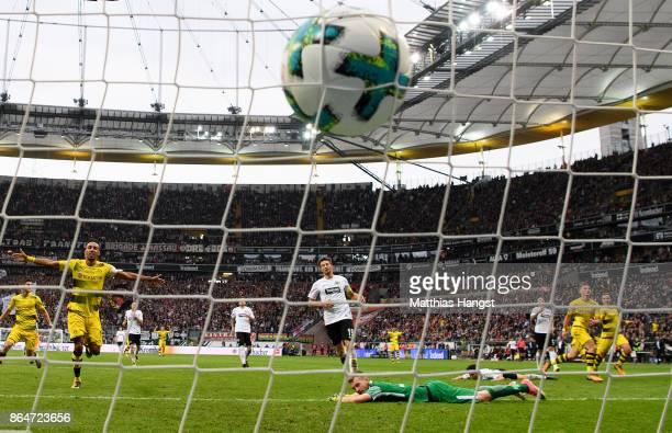 Maximilian Philipp of Dortmund scores his team's second goal past goalkeeper Lukas Hradecky of Frankfurt during the Bundesliga match between...