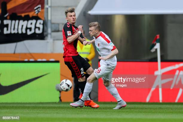 Maximilian Philipp of Freiburg and Georg Teigl of Augsburg battle for the ball during the Bundesliga match between FC Augsburg and SC Freiburg at WWK...